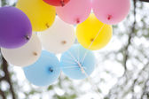 Many colored balloons forming a bright background wallpaper imag — Stock Photo