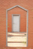 Brick wall & barred door — Stock Photo