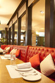 Leather chairs near mirror in steak restaurant — Stock Photo