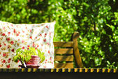 Decorative pillow natural Fabric on outdoor table — Stock Photo
