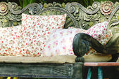 Close up picture of many pillows on a wooden sofa — Stock Photo