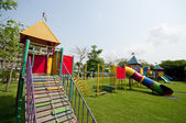 Big colorful children playground equipment in middle of park — Stock Photo