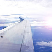 View of jet plane wing with cloud patterns — Stock Photo