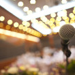 Close up of microphone in concert hall or conference room — Stock Photo #27178605