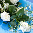 Bouquet with white  roses on blue background — Stock Photo