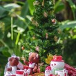Decorated christmas tree with lots of presents in the park — Stock Photo #27185383