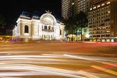The opera house of Saigon Vietnam with stream of passing traffic — Stock Photo