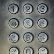 Stock Photo: Close up image of a public pay phone keypad