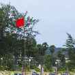 Andaman beach with red flag for danger zone — Stock Photo