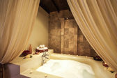 Asian style jacuzzi in spa room — Stock Photo