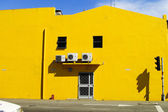 Yellow building wall with door and window on the road. Melaka. M — Stock Photo
