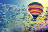 Hot air balloon on sea with cloud — Stock Photo