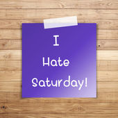 I hate saturday on sticky paper on Brown wood plank wall texture — Stock Photo