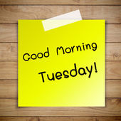 Good morning tuesday on sticky paper on Brown wood plank wall te — Stock Photo