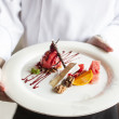 Dessert on chef hand — Stock Photo