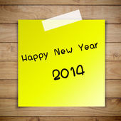 Happy New Year 2014 on sticky paper on Brown wood plank wall tex — Stock Photo