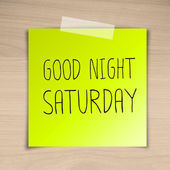 Good night saturday sticky paper on brown wood background textur — Stock Photo