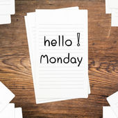 Hello Monday on paper and wood table desk — Stock Photo