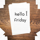 Hello Friday on paper and wood table desk — Stock Photo