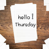 Hello Thursday on paper and wood table desk — Stock Photo