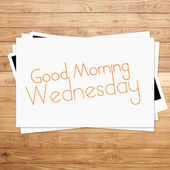 Good Morning Wednesday on paper and Brown wood plank background — Stock Photo