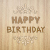 Happy Birthday on wooden texture background — Stock Photo