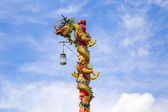 Chinese dragon on blue sky with cloud — Stock Photo