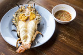 Big prawn on dish with spicy sauce — Stock Photo