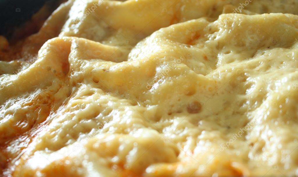 Lasagna cheese crust detail — Stock Photo #13568453