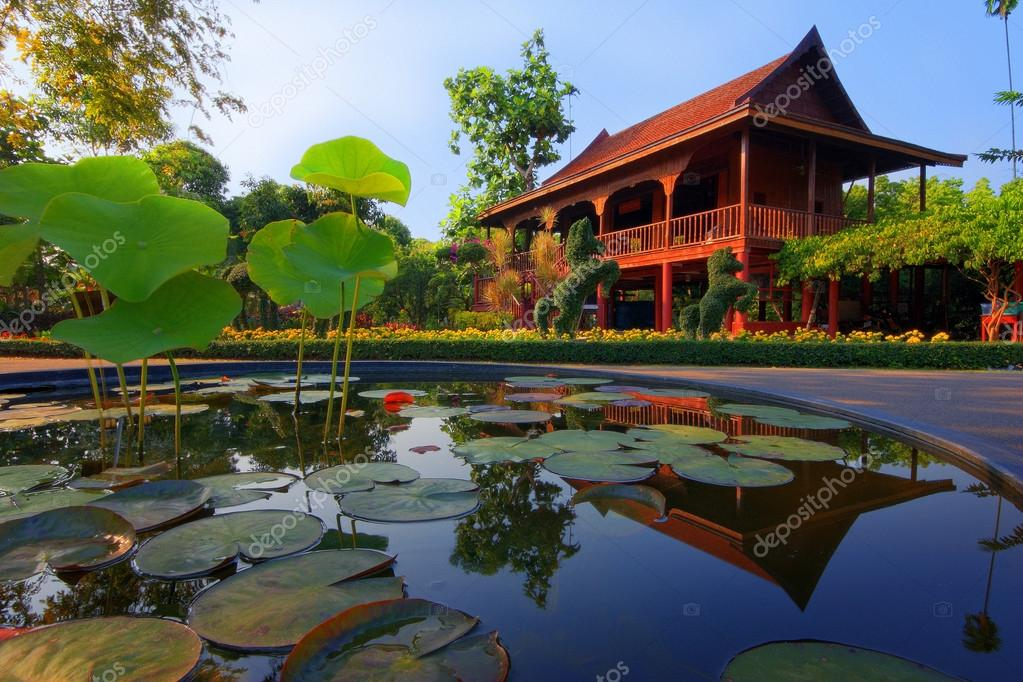 Thai style house reflected in lotus pond,Thailand  Stock Photo #12905199