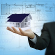 Businessman present house model and plan on touch screen — Stock Photo #12936800