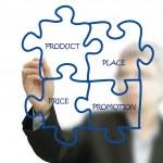 Businessman hand draws puzzle diagram on white board — Stock Photo #12941690