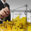 Stock Photo: Draws golden building development concept
