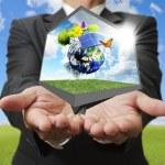 Businessman show green earth concept — Stock Photo #12943957