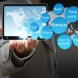 Success icon diagram and tablet computer — Stock Photo