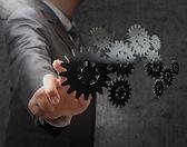 Affärsman visar redskap till framgång — Stockfoto