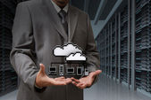 Businessman show cloud network icon on server room — Stock Photo