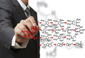 Chemist draws a molecular structure — Stock Photo