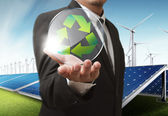 Businesss man shows recycle glass shield as concept — Stockfoto