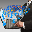 Business man pressing computer laptop and social network - Stock Photo
