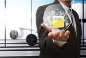 Business man hand shows travel shield at the airport — Stock Photo