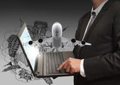 Business man shows laptop and dream travel — Stock Photo