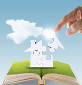 Open book of hand complete puzzle home — Stock Photo