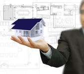 House model and plan on touch screen — Stock Photo