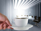 Coffee cup and board room — Stock Photo