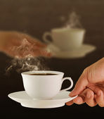Male and female hands, love and coffee — Stock Photo