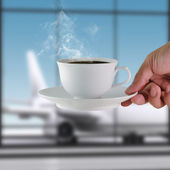 Coffee cup at the airport — Stock Photo
