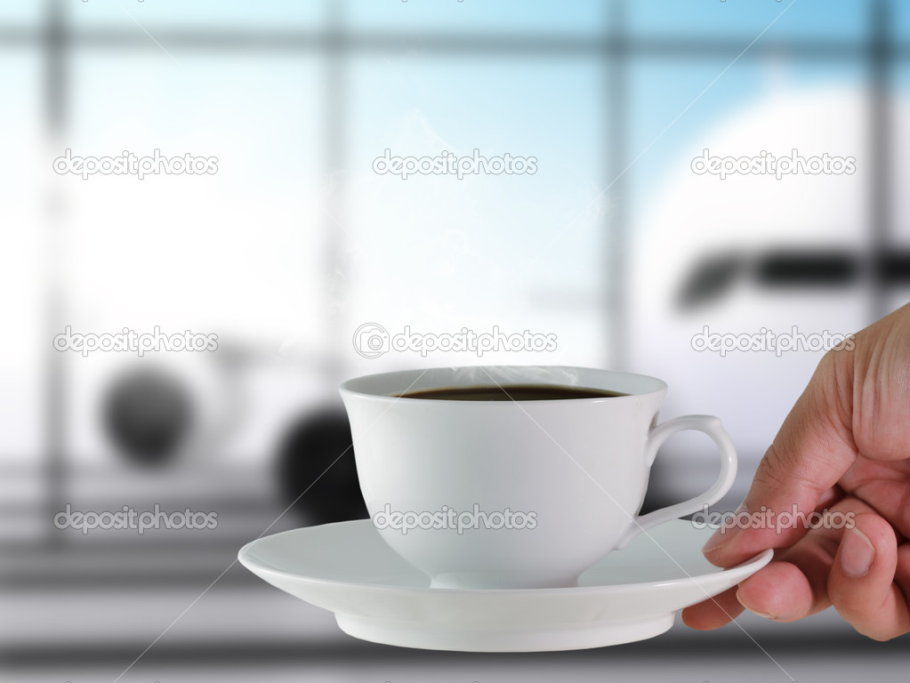 Coffee cup at the airport — Stock Photo #12978504