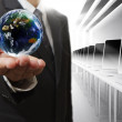 Business man hand holds globe — Stock Photo