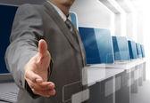 Business man offers handshake — Stock Photo